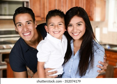 Happy young couple who are standing with their son