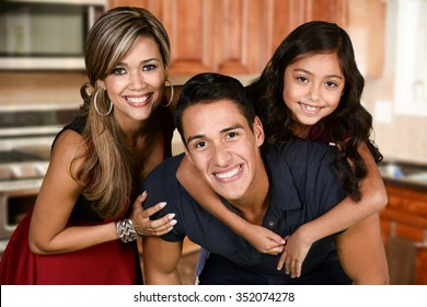Happy young couple who are standing with their daughter