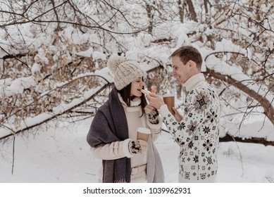 Happy Young Couple in Winter Park having fun.Family Outdoors. love.