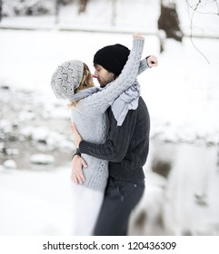 Happy Young Couple in Winter Park having fun.Family Outdoors. love