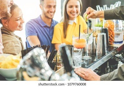 Happy young couples having fun at american bar in summer time - Young friends drinking cocktails and laughing together - Focus on left man mouth - Party, youth, and trendy lifestyle concept