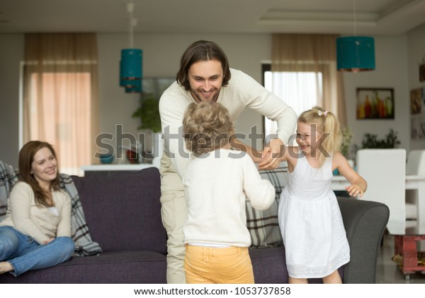 Happy Young Dad Having Fun Kids Stock Photo Edit Now 1053737858