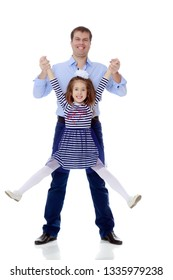 Happy young dad raise his beloved daughter's hands.Isolated on white background.
