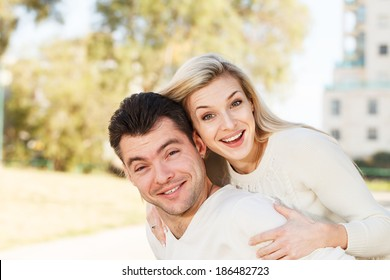 Happy Young disabled man and his girlfriend piggyback