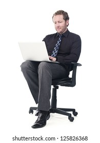 Happy young doctor working on a laptop over white background