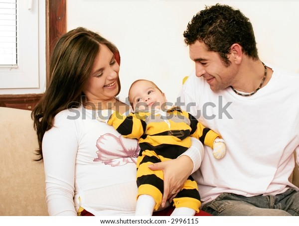Happy young family with baby