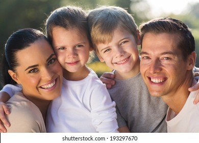 happy young family closeup portrait outdoors