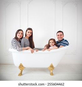 Happy young family dressed in sailors in bath. Summer travel, adventure and vacation concept