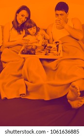happy young family eat breakfast in bed at morning duo tone
