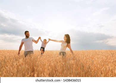 Happy young family enjoy time together outside. Mom, dad and little baby son rest outdoors.  togetherness, love, happiness concept