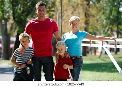 Happy young family enjoying a spring day outdoors