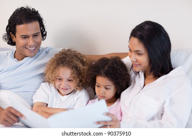 Happy young family enjoys reading a story together