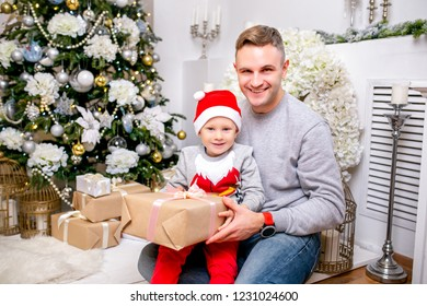 happy young family father mother and son in christmas evening in home