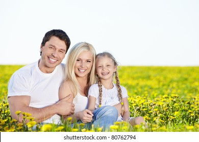 Happy young family in the field