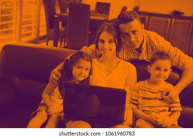happy young family have fun and working on laptop at modern  home livingroom indoor duo tone