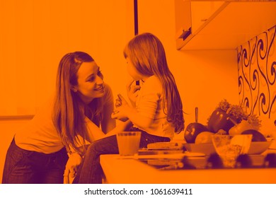 happy young family have lunch time with fresh fruits and vegetable food in bright kitchen duo tone