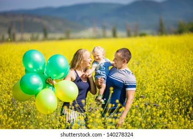 Happy young family having fun outdoors on a summer day