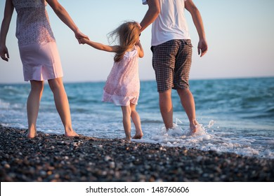 happy young family having fun on the beach