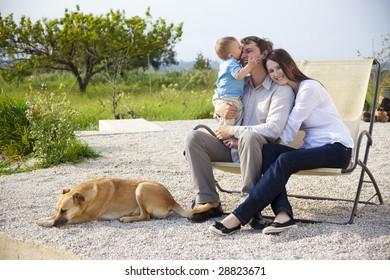 happy young family having fun in garden