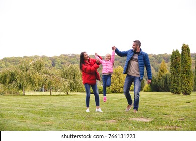 Happy young family having fun together at the park