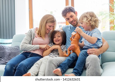 Happy young family at home