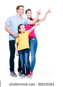 Happy young family with kid pointing finger up -  isolated on white background
