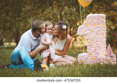 happy young family with little daughter