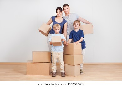 Happy young family moving into new house
