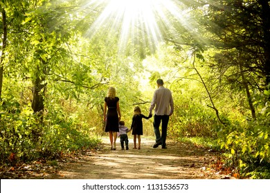 happy young family in nature
