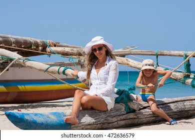 Happy young family on a tropical beach