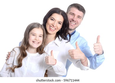 Happy young family on a white background