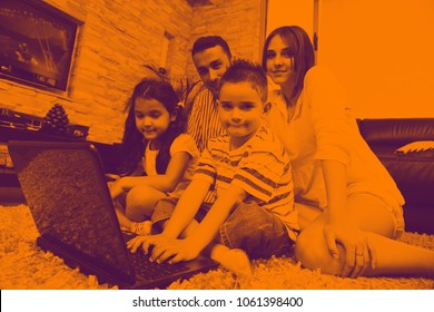 happy young family relax and have fun at modern home indooor duo tone