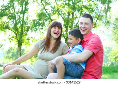 happy young family relaxing in park
