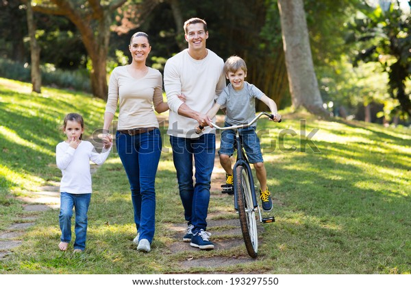 happy young family spend quality time together in the park