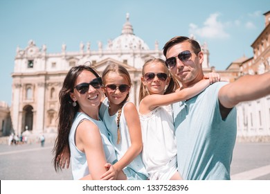 Happy young family taking selfie at St. Peter's Basilica church in Vatican city, Rome. Happy family on european vacation in Italy.