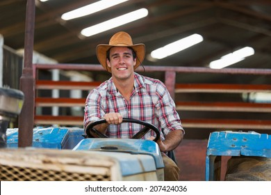 happy young farmer driving tractor