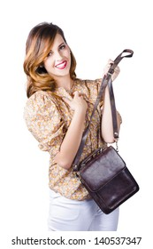 Happy young fashionable woman with leather hand bag, white studio background