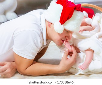Happy young father and baby