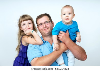 Happy young father and young children