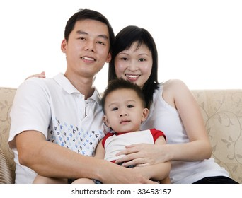 Happy young father, mother and son.