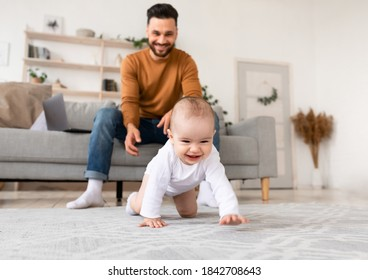 Happy Young Father Playing With Baby Toddler Having Paternity Leave, Bonding With Little Daughter At Home. Child Care, Cute Fatherhood Moments, Parenting Happiness. Selective Focus