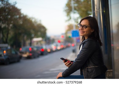 Happy young female in the city on coffe break
