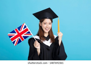 happy Young female graduation student showing the United Kingdom   flag
