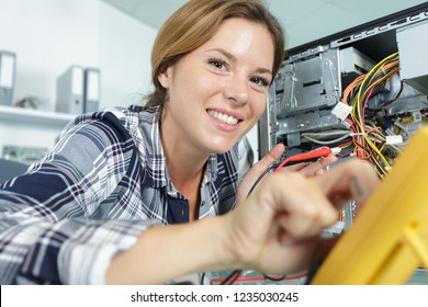 happy young female pc technician in class