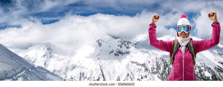 Happy young female skier, winner