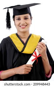 Happy young female student holding diploma against white background