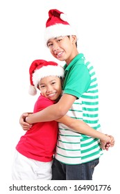 Happy young friends hugging at christmas. Isolated in white background.