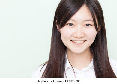 happy young girl against pale green background