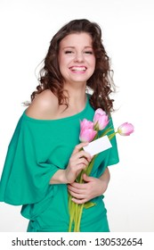 Happy young girl with a beautiful smile and spring flowers and blank card for your text on white background on Holiday