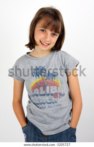 Happy young girl with her hands in her jean pockets